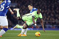 Yaya Toure of Manchester City goes flying as he is tackled by Muhamed Besic of Everton. Capital one cup semi final 1st leg match, Everton v Manchester city at Goodison Park in Liverpool on Wednesday 6th January 2016.<br /> pic by Chris Stading, Andrew Orchard sports photography.
