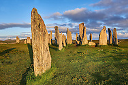 Outer row of stones, 27 metres long,  leading to the central stone circle, circa 2900BC. Calanais Neolithic Standing Stone (Tursachan Chalanais) , Isle of Lewis, Outer Hebrides, Scotland. .<br /> <br /> Visit our SCOTLAND HISTORIC PLACXES PHOTO COLLECTIONS for more photos to download or buy as wall art prints https://funkystock.photoshelter.com/gallery-collection/Images-of-Scotland-Scotish-Historic-Places-Pictures-Photos/C0000eJg00xiv_iQ<br /> '<br /> Visit our PREHISTORIC PLACES PHOTO COLLECTIONS for more  photos to download or buy as prints https://funkystock.photoshelter.com/gallery-collection/Prehistoric-Neolithic-Sites-Art-Artefacts-Pictures-Photos/C0000tfxw63zrUT4