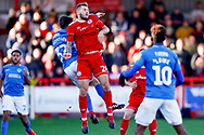 Accrington Stanley defender Nick Anderton (24) on loan from Blackpool, wins the header during the EFL Sky Bet League 1 match between Accrington Stanley and Portsmouth at the Fraser Eagle Stadium, Accrington, England on 27 October 2018.