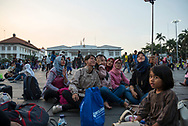 Jakarta, Indonesia - July 8, 2017: In Fatahillah Square, the busy heart of Jakarta's Old Town -- also called Kota, or Batavia - a group of young people smile for a selfie at sunset.