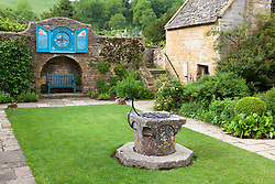 Well Court at Snowshill Manor with the Nychthemeron clock on the wall