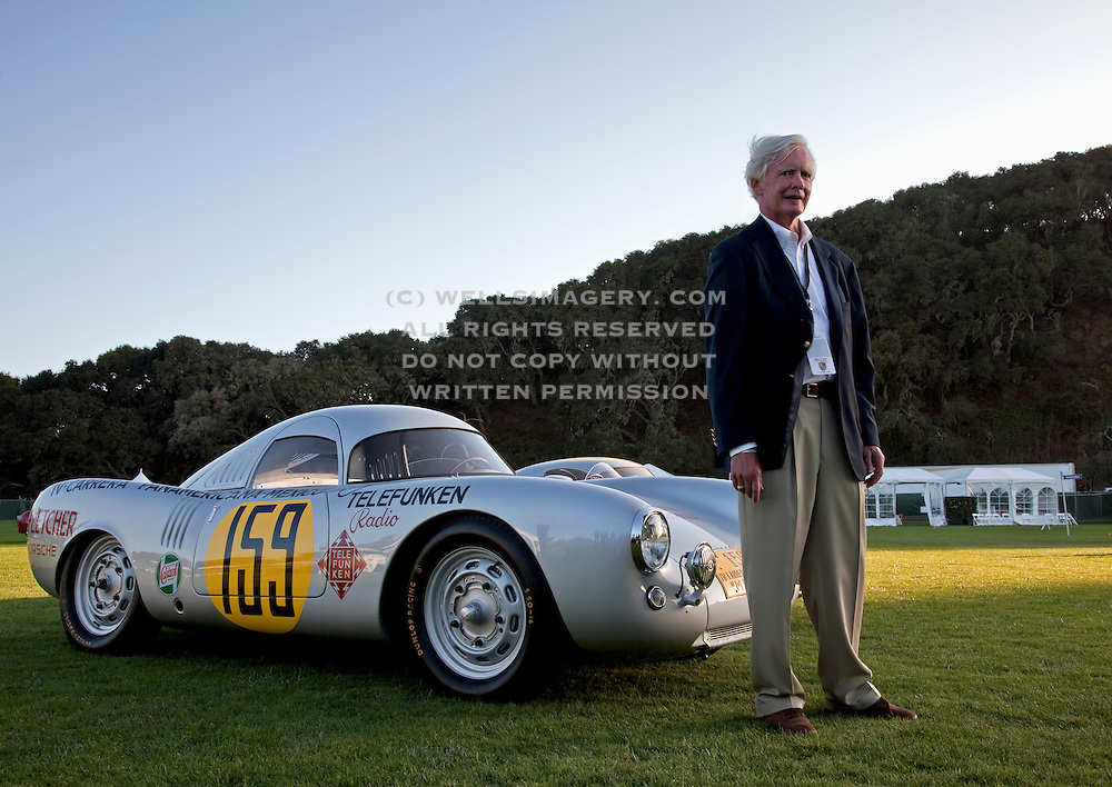 Image of the director of the Porsche Race Car Classic standing next to Jerry Seinfeld's Porsche 550-03 Spyder, Quail Lodge, Carmel, California, America west coast.