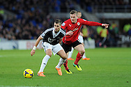 Southampton's Morgan Schneiderlin holds off Aron Gunnarsson of Cardiff city. Barclays Premier league, Cardiff city v Southampton at the Cardiff city Stadium in Cardiff,  South Wales on Boxing day, Thursday 26th Dec 2013. <br /> pic by Andrew Orchard, Andrew Orchard sports photography.