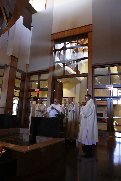 Bishop Richard J. Sklba blesses the water at St. Stephen Church Sunday, Nov. 22.