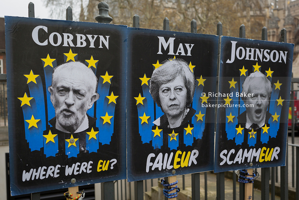 On the day that Theresa May meets with her cabinet to prepare for a No Deal Brexit, the faces of leading and controversial cross-party politicians involved in Brexit issues have been attached to railings opposite parliament in Westminster by protestors, on 2nd march 2019, in London, England. From left to right: Jeremy Corbyn, Prime Minister Theresa May and Boris Johnson.