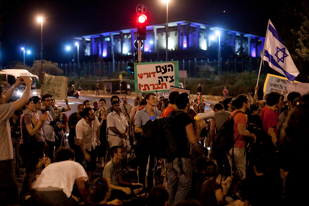 Israelis block an intersection in front of Israel's parliament, the Knesset in Jerusalem, during a protest against rising housing and property prices on July 24, 2011. Over the past two weeks, Israelis have set up tent camps in cities throughout the country, in demonstration of social inequalities and the high cost of living.