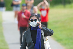 ©Licensed to London News Pictures 12/05/2020<br /> Greenwich, UK. A lady wearing sunglasses and a protective mask. People come out of Coronavirus lockdown to enjoy the warm weather by relaxing in Greenwich park, Greenwich, London this afternoon. Photo credit: Grant Falvey/LNP