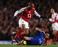 Photo: Javier Garcia/Back Page Images<br />Arsenal v Chelsea, FA Barclays Premiership, Highbury 12/12/04<br />Thierry Henry avoids a Frank Lampard tackle