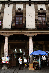A worker stands in the Santo Domingo square, on Tuesday, October 20, 2009, in Mexico City, Mexico.  There are many outfits on the famed Santo Domingo square that help Mexicans evade taxes by selling them fake receipts and invoices that they use to deduce expenses they never made.