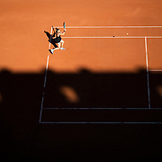 PARIS, FRANCE June 10. Maria Sakkari of Greece in action during her match against Barbora Krejcikova of the Czech Republic as the early evening shadows creep across Court Philippe-Chatrier during the semi finals of the Women's singles competition at the 2021 French Open Tennis Tournament at Roland Garros on June 10th 2021 in Paris, France. (Photo by Tim Clayton/Corbis via Getty Images)