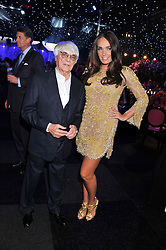 BERNIE ECCLESTONE and his daughter TAMARA ECCLESTONE at the F1 Party in aid of Great Ormond Street Hospital Children's Charity held at Battersea Evolution, Battersea Park, London on 4th July 2012.