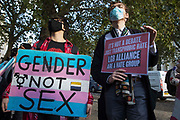 Transgender Action Block activists and supporters protest outside the first annual conference of the LGB Alliance at the Queen Elizabeth II Centre on 21st October 2021 in London, United Kingdom. Many LGBT+ activists and advocacy groups are opposed to the LGB Alliance, a government-registered charity, which they consider to be a divisive anti-trans campaign group.
