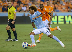 August 4, 2018 - Houston, TX, U.S. - HOUSTON, TX - AUGUST 04:  Sporting Kansas City forward Gianluca Busio (13) keeps the ball away from Houston Dynamo midfielder Oscar Garcia (27) during the soccer match between Sporting Kansas City and Houston Dynamo on August 4, 2018 at BBVA Compass Stadium in Houston, Texas.  (Photo by Leslie Plaza Johnson/Icon Sportswire) (Credit Image: © Leslie Plaza Johnson/Icon SMI via ZUMA Press)