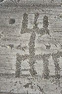 """Petroglyph, rock carving, of schematic human figures in the so called """"Prayer"""" position. Carved by the ancient Camuni people in the Late Copper Age between 3200- 2200 BC. Rock no 24,  Foppi di Nadro, Riserva Naturale Incisioni Rupestri di Ceto, Cimbergo e Paspardo, Capo di Ponti, Valcamonica (Val Camonica), Lombardy plain, Italy .<br /> <br /> Visit our PREHISTORY PHOTO COLLECTIONS for more   photos  to download or buy as prints https://funkystock.photoshelter.com/gallery-collection/Prehistoric-Neolithic-Sites-Art-Artefacts-Pictures-Photos/C0000tfxw63zrUT4<br /> If you prefer to buy from our ALAMY PHOTO LIBRARY  Collection visit : https://www.alamy.com/portfolio/paul-williams-funkystock/valcamonica-rock-art.html"""
