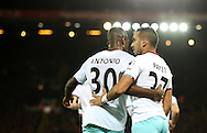 Michail Antonio celebrates with Dimitri Payet of West Ham United after scoring during the Premier League match at Anfield Stadium, Liverpool. Picture date: December 11th, 2016.Photo credit should read: Lynne Cameron/Sportimage