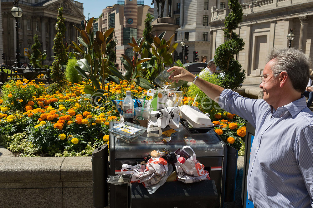 A pile of lunchtime litter is added to by a City worker outside the Bank of England during the 2018 heatwave in the City of London, the capitals historic financial district, on 2nd August 2018, in London, England.