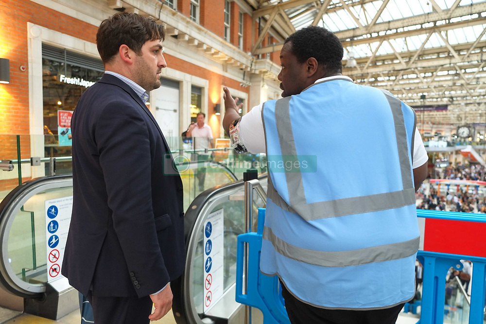 August 7, 2017 - London, United Kingdom - Commuter being directed by station staff  at Waterloo Station on 7th August 2017 at evening rush hour as engineering work continues on Platform 1 - 10 throughout August causing major disruption to passengers. (Credit Image: © Claire Doherty/Pacific Press via ZUMA Wire)