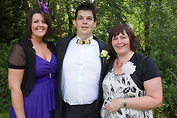 Visually impaired bridegroom with sister and mother.