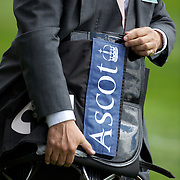 An official carries a saddle at Royal Ascot Race Course. Royal Ascot is one of the most famous race meetings in the world, frequented by Royalty and punters from the high end of society to the normal everyday working class. Royal Ascot 2009, Ascot, UK, on Tuesday, June 16, 2009. Photo Tim Clayton