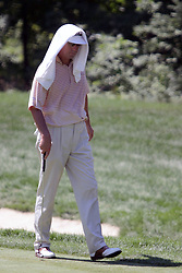 16 July 2006 Dan Forsman don's a cool wet towel to try and beat the sweltering mid 90 degree heat and high humidity that prevailed the last 2 days of the tournament. The John Deere Classic is played at TPC at Deere Run in Silvis Illinois, just outside of the Quad Cities