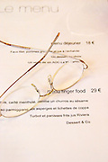 The menu with a pair of steel wire glasses on top, the restaurant Blanc Le Bistrot in Toulon, very design art-deco Toulon Var Cote d'Azur France