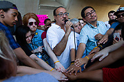 Organizers and participants of the Families Belong Together event in front of Dallas City Hall in downtown Dallas get together for a final event prayer on Thursdayat the end of the protest.