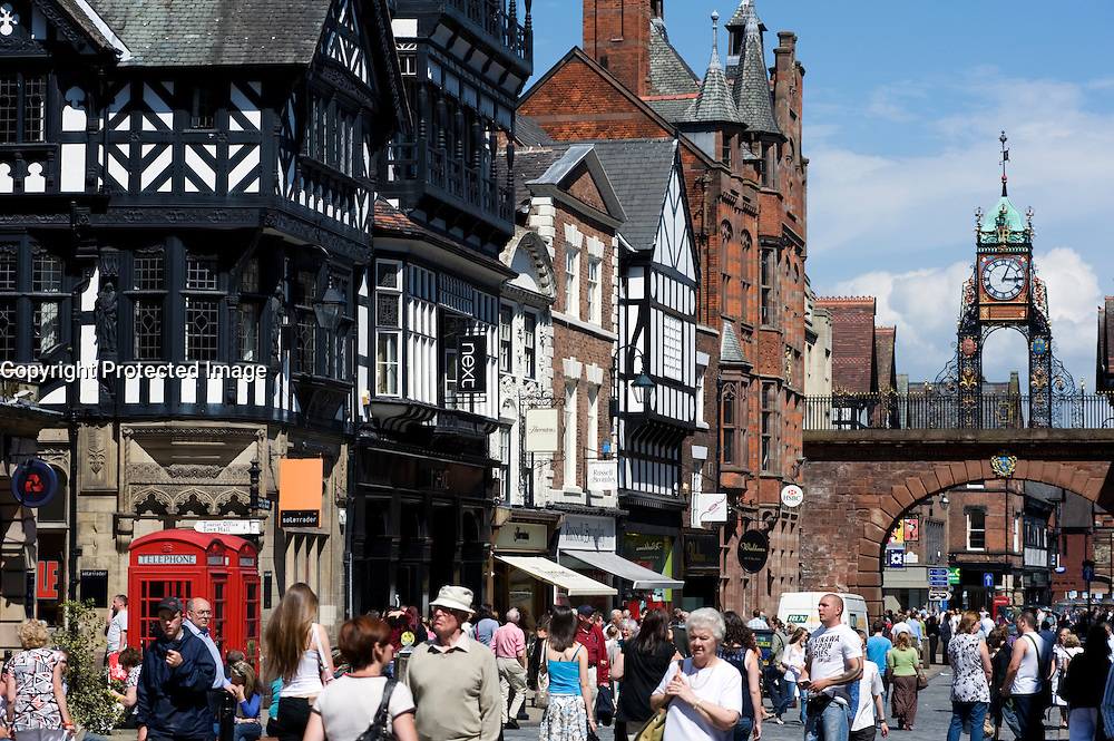 Period buildings and famous clock  on busy  Eastgate Street in Chester Cheshire England 2008