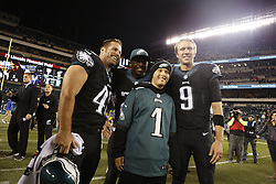 Philadelphia Eagles long snapper Jon Dorenbos #46, running back LeSean McCoy #25, and quarterback Nick Foles #9 pose for a picture with an Eagles Guest after the NFL game between the New York Giants and the Philadelphia Eagles at Lincoln Financial Field in Philadelphia on Sunday October 12th 2014. The Eagles won 27-0. (Brian Garfinkel/Philadelphia Eagles)