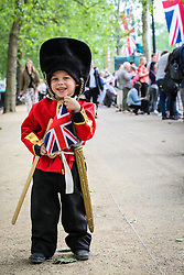 © Licensed to London News Pictures. 11/06/2016. London, UK. A young boy dressed as a member of the Queen's Household Division on Pall Mall ahead of Trooping the Colour. Trooping the Colour, a military parade of the Queen's Household Division, takes place annually and this year marks Her Majesty's  official 90th birthday. Photo credit: Rob Pinney/LNP