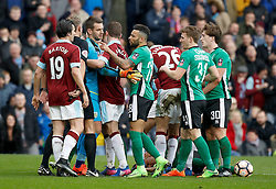 Lincoln City's Nathan Arnold points at referee Graham Scott during an argument during the Emirates FA Cup, Fifth Round match at Turf Moor, Burnley.