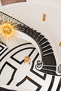 Overhead view of elegant staircase in a luxury home. Designed by Deborah Walker.