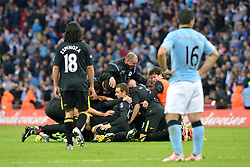 File photo dated 11-05-2013 of Manchester City's Sergio Aguero stands dejected as Wigan Athletic players and staff celebrate behind, after the final whistle