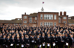 © Licensed to London News Pictures. 9/11/2012. Solihull, West Midlands. All 1,000 (one thousand) pupils at Solihull School along with Teachers and Governors, fell silent today, as they stood together in silence to mark remembrance day with a special service. The school quadrangle is filled with pupils standing in silence. Photo credit : Dave Warren/LNP