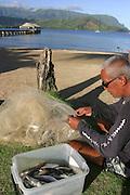 Net fisherman, Hanalei, Kauai, (editorial use only, no model release)<br />