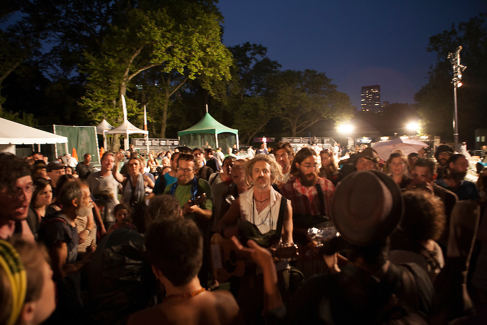 """After the end of the concert, a group from Occupy Wall Street started singing """"This Land is Your Land,"""" written by Woody Guthrie."""