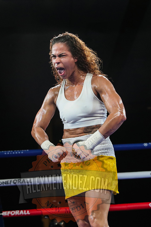 Melissa Parker celebrates her victory over Maria Roman during a One For All Promotions boxing event at the Caribe Royale Orlando Events Center on Saturday, February 20, 2021 in Orlando, Florida. (Alex Menendez via AP)