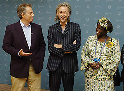 "Prime Minister Tony Blair (left) alongside Bob Geldof and Kenyan Nobel Laureate Wangari Maathai. Blair paid tribute to the anti poverty campaign led by Geldof himself- dubbing it ""the most extraordinary civic society campaign I have ever come across""."