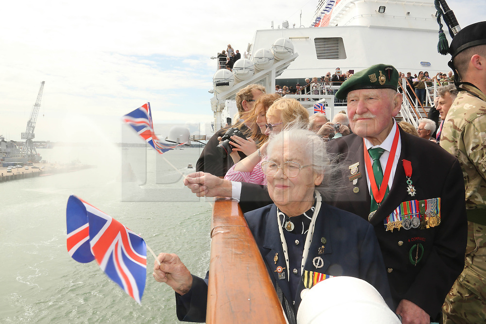 © Licensed to London News Pictures. 03/06/2014. Portsmouth, UK. 90 YEAR OLD D DAY VETERAN PAT CHURCHILL FROM WITNEY WHO LANDED ON JUNO BEACH SAILS OUT FROM PORTSMOUTH TO NORMANDY . Photo credit : Jason Bryant/LNP