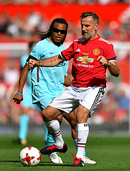 Manchester United's Karel Poborsky (right) in action as Barcelona's Edgar Davids looks on during the legends match at Old Trafford, Manchester.