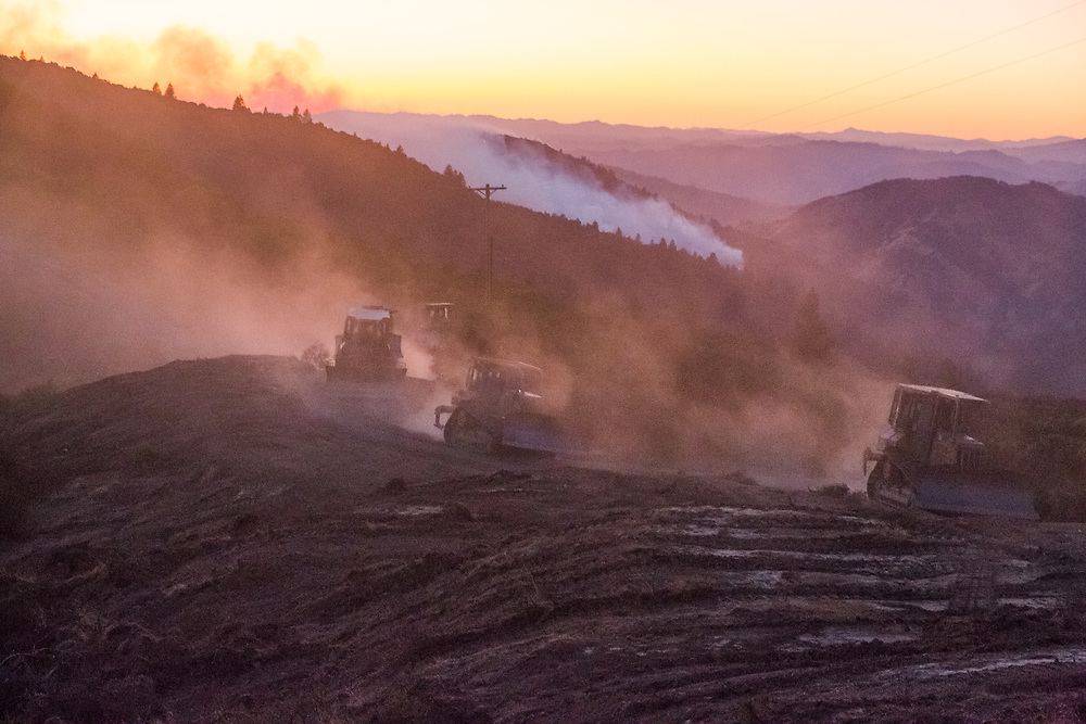 Bulldozers return from clearing a line on the Pocket Fire near Geyserville, CA on October 13, 2017. The northern California wildfires of 2017 were a series of late-season fires driven by local wind events that reached hurricane force.