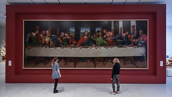 "© Licensed to London News Pictures. 14/05/2018. LONDON, UK. Gallery staff are seen in the new Collection Gallery viewing, (L to R) Leonardo Da Vinci 's ""The Last Supper"", copy made 1515-20, at a photocall for the opening of the new Royal Academy of Arts (RA) in Piccadilly.  As part of the celebrations for its 250th anniversary year, redevelopment has seen the RA's two buildings, 6 Burlington Gardens and Burlington House, united into one extended campus and art space extending from Piccadilly to Mayfair.  Photo credit: Stephen Chung/LNP"