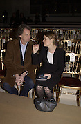 Paul Smith and Amy Spindler. Yves St. Laurent. last couture collection, 1962-2002. Pompidou Centre. Paris. 22 January 2002. © Copyright Photograph by Dafydd Jones 66 Stockwell Park Rd. London SW9 0DA Tel 020 7733 0108 www.dafjones.com