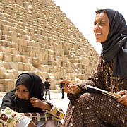 A mother and daughter, souvenir sellers at the Giza Pyramids. Near Cairo, Egypt.