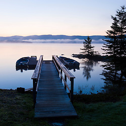 """The boat dock on First Connecticut Lake at """"The Glen"""" in Pittsburg, new Hampshire.  Dawn."""