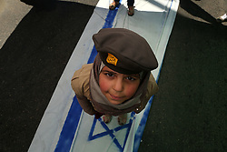 June 23, 2017 - Gaza, Gaza Strip - Palestinian children walk on Israeli flag painted during a march marking Jerusalem Day in support of the Palestinian resistance against the Israeli occupation, in Gaza City. Every year Iran is the last Friday of Ramadan, the day of solidarity with the Palestinians. (Credit Image: © Majdi Fathi/NurPhoto via ZUMA Press)