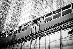 Chicago elevated El Train in black and white in downtown Chicago.