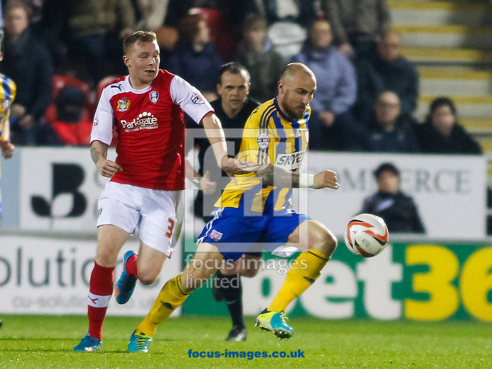 Nicky Adams of Rotherham United and Alan McCormack of Brentford during the Sky Bet League 1 match at the New York Stadium, Rotherham<br /> Picture by Mark D Fuller/Focus Images Ltd +44 7774 216216<br /> 25/03/2014