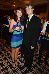 PAUL MERTON and his wife SUKI at the 90th birthday party for Nicholas Parsons held at the Hyatt Churchill Hotel, Portman Square, London on 8th October 2013.