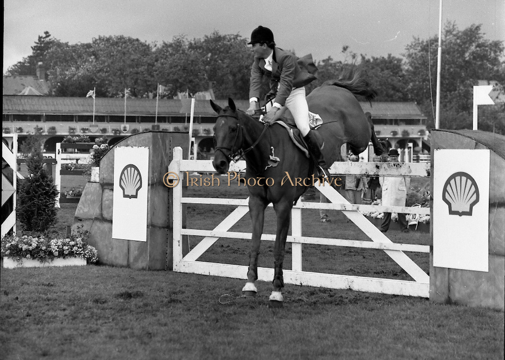 Shell Sponsored Events At The Dublin Horse Show.(R39).1986..07.08.1986..08.07.1986..7th August 1986..At the Horse Show Shell sponsored both the Speed and Power competition and The Puissance..The Speed and Power event was won by Hap Hanson riding 'Gambrinus'. The Puissance was shared by Capt John Ledingham (Irl) on 'Kilcoltrim' and Nick Skelton (GB) on 'Raffles Apollo' who both cleared the high wall at 7feet...Image shows Peter Charles (GB) on'Merrimandias' taking part in the Speed and power event.