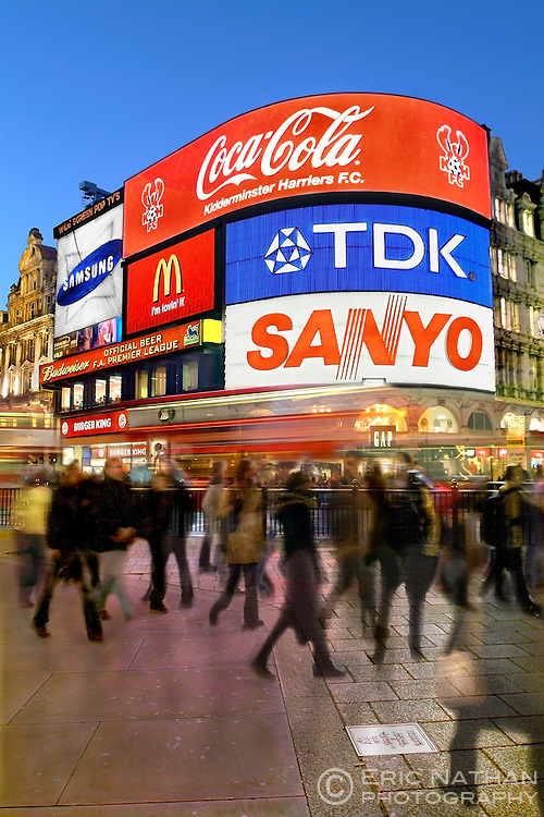 Piccadilly Circus in London with its neon/digital signs in the early evening.